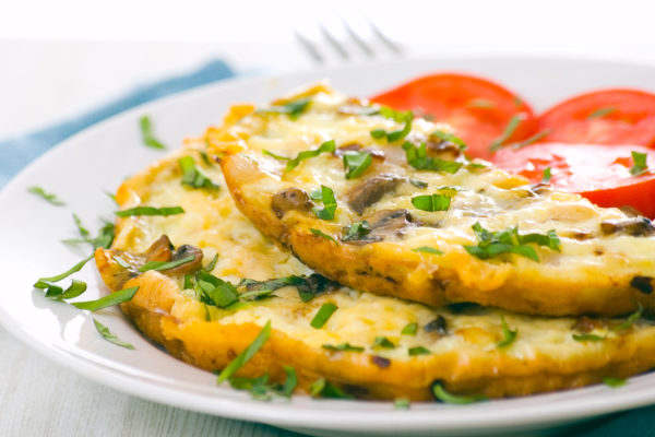 Omelette with onion, tomato, mushrooms and herbs
