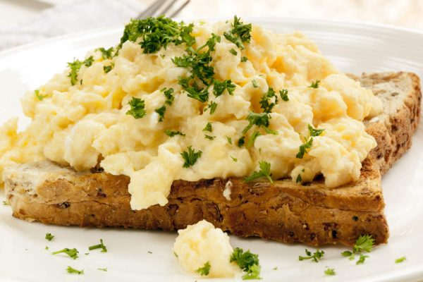 Scrambled eggs and cottage cheese on toast